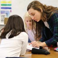 Elementary teacher helping student with work